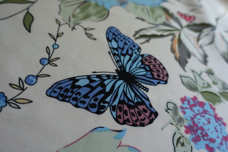 Thin fabric with delicate romantic butterfly pattern