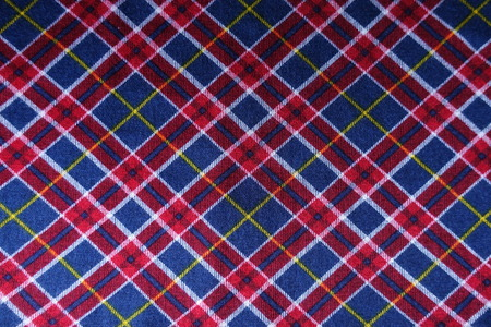 Checked plaid fabric in red, blue and white from above Stock Photo