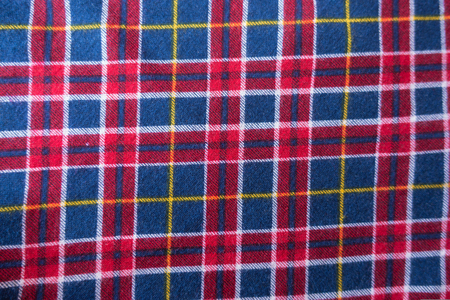 Textile with plaid pattern in red, blue and white