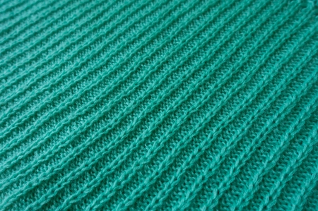 motton blue: Diagonal view of wales on handmade knitted fabric