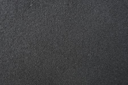 Plain blank black coat fabrics from above Stock Photo