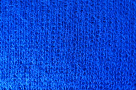 Close up of handmade blue knit fabric