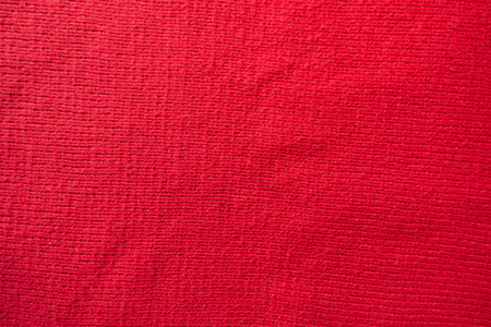 Handmade plain red stockinette fabric from above