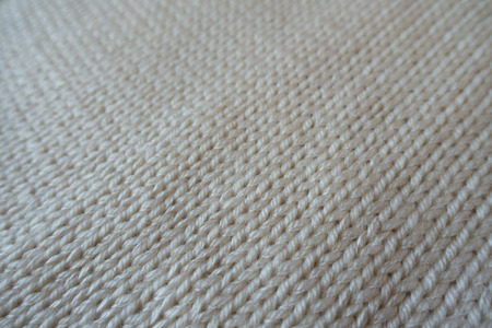 Close up of handmade plain white stockinette stitch knitwork