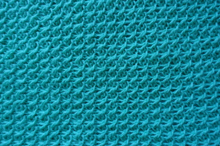 motton blue: Close up of handmade knitwork from above