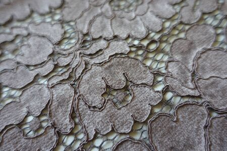 Close up of glossy gray guipure lace