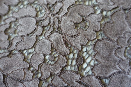 Close up of silver guipure lacy fabric