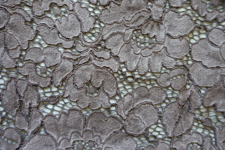 Dark grey guipure lacy fabric from above