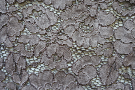 Deep gray guipure lacy fabric from above