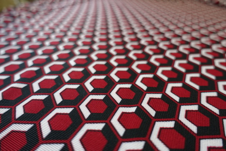 Macro of colorful honeycomb pattern on fabric Stock Photo