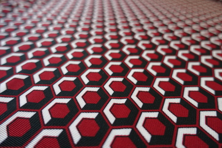Close view of honeycomb printed fabric in red, white and black