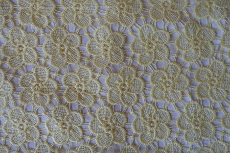 Yellow lace with floral pattern from above