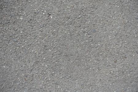 Macro of grained texture of dusty asphalt