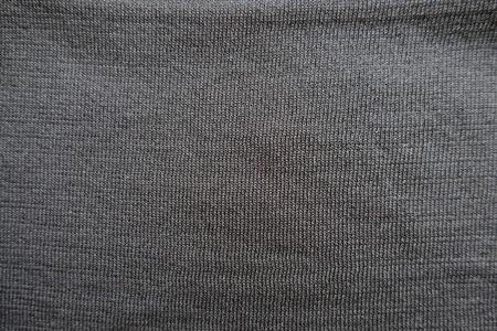 gauzy: Close up of surface of plain black polyester stockinet