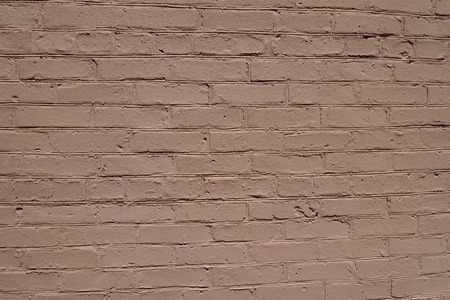 exasperate: Light brown simple painted brick wall surface Stock Photo