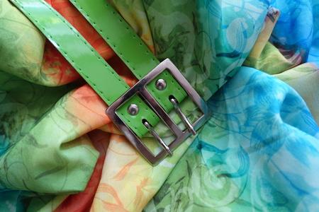 Metallic buckle and green belt on rayon Stock Photo