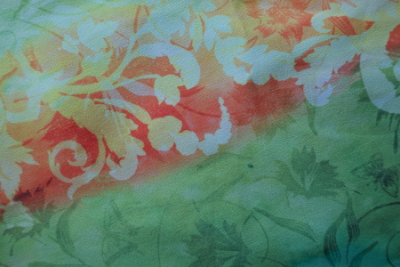 gauzy: Orange and green rayon fabric with floral print