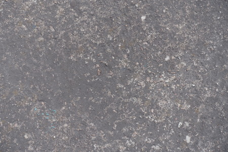exasperate: Surface of dark grey concrete slab from above