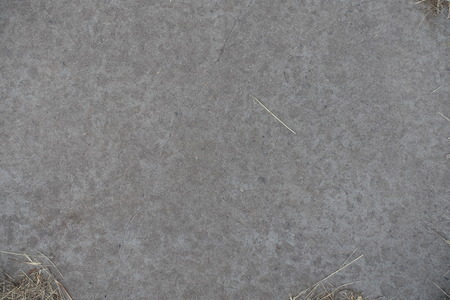 exasperate: View of grey concrete slab from above