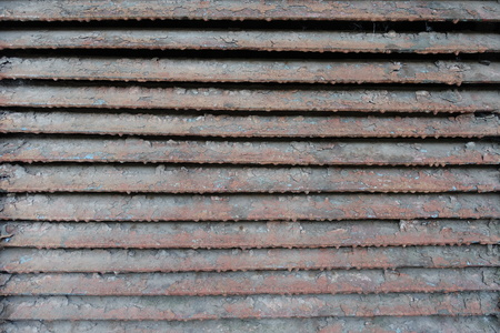 exasperate: Old rusty dirty peeled horizontal metallic slats