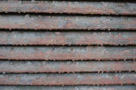 exasperate: Weathered painted louver of angled metallic slats Stock Photo