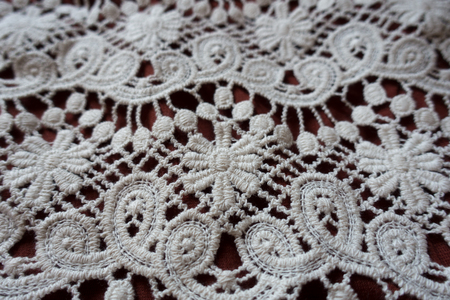 Close view of white lace with floral pattern