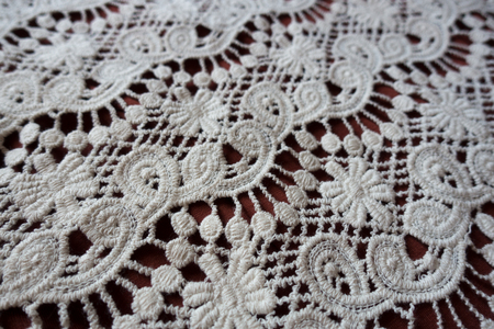 Diagonal view of white retro styled lace