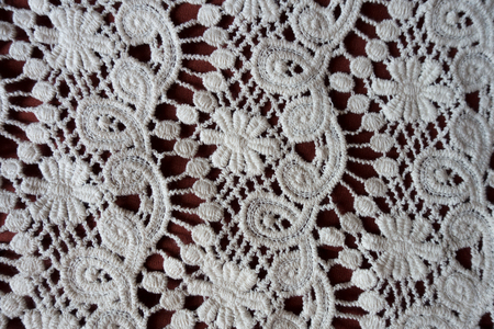 Vintage white perforated lacy fabric from above Imagens