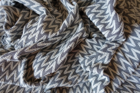 Thick gray patterned fabric in soft folds Stok Fotoğraf