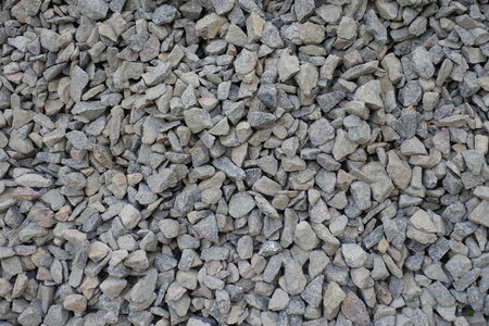 Close view of grey irregular crushed stone
