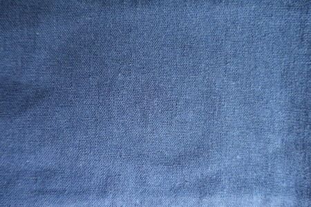 Simple blue linen fabric surface from above