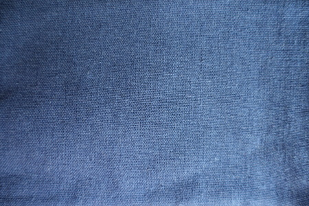 Surface of simple blue linen fabric from above Stock Photo