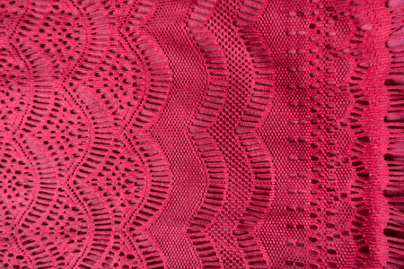 Bright red lacy fabric with geometric pattern from above Imagens