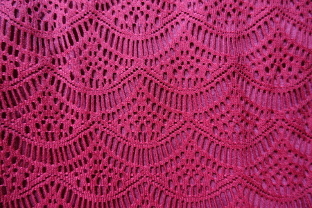 Cerise fabric with waves pattern from above