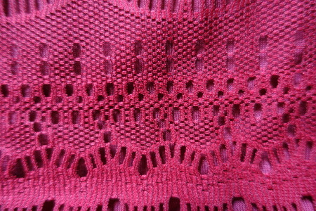Closeup of detail of red lacy fabric