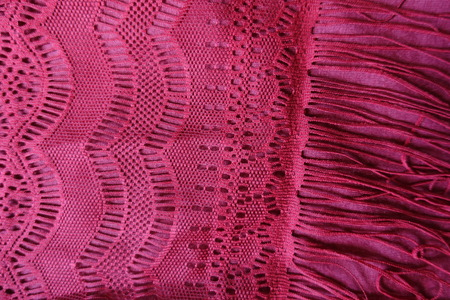Fringe on the edge of lacy cotton fabric