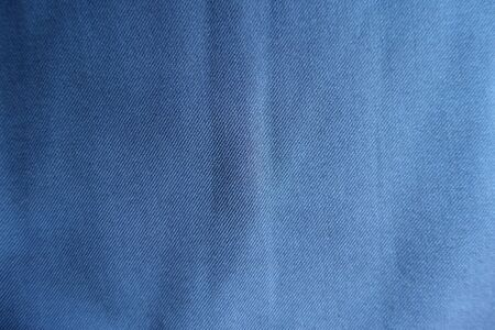 Surface of simple blue fabric from above