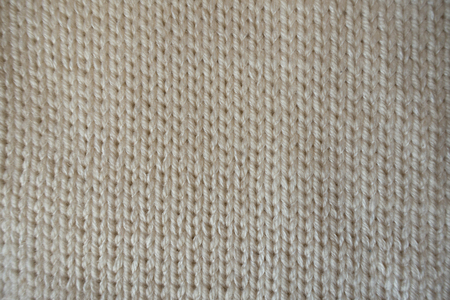 Close Up Of Grey Handmade Plain Knit Stitch Fabric Stock Photo