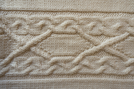 Ivory handmade knitwork with horizontal plait pattern from above