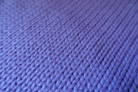 Close up of violet handmade stockinet fabric