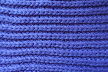 Handmade violet knitted fabric with horizontal ribbing pattern