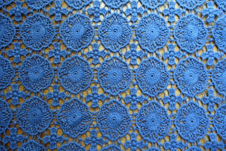 Cotton lacy fabric on wood from above