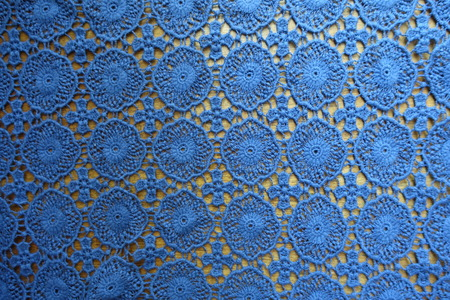 Pale blue lacy fabric on wood from above Imagens