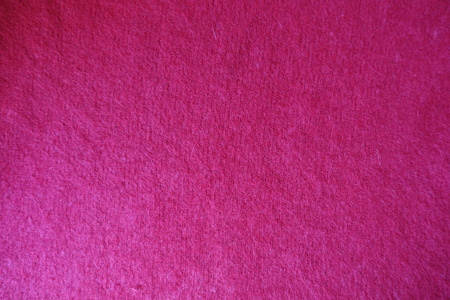 Handmade red plain knitted fabric from above