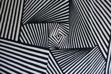 Black and white fabric with geometric pattern from above