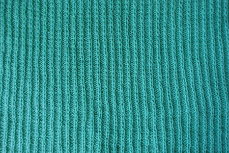 Simple vertical ribbing on handmade knitted fabric