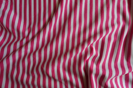 Crumpled striped fabric in pink and white