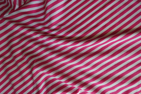 Draped striped fabric in pink and white Stok Fotoğraf