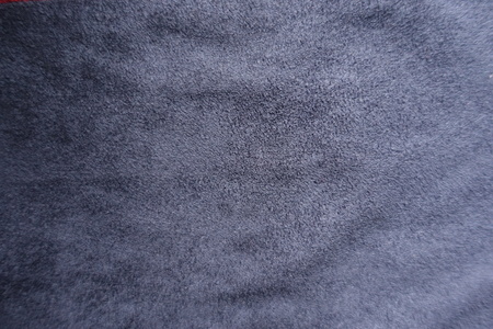 Navy blue artificial suede fabric surface from above