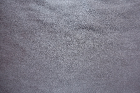Pinkish grey artificial suede fabric from above
